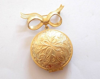 1970's Avon New York Gold Bow Solid Perfume in Locket Brooch