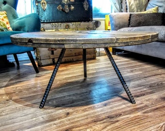 Reclaimed spool top coffee table on rebar legs for: Advance cnc machining