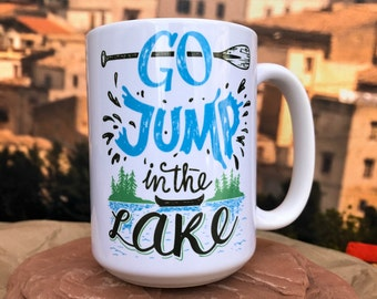 Go Jump in The Lake 11oz or 15oz Coffee Mug.