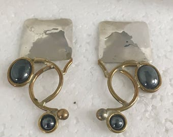 Sterling silver square stud earrings with brass wire design and hematite stones