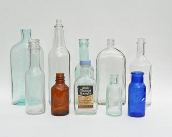 Ten Vintage Glass Bottles Clear Blue Brown - Bromo Seltzer - Mustang Liniment - Lysol - Rexall Throat Gargle - Lea Perrins - Jergens