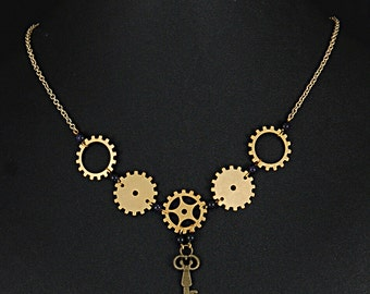 Elegantly simple brass steampunk gear necklace with key by Sylvan Creations.