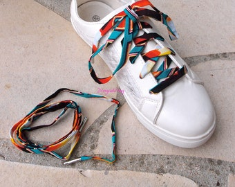 Shoe laces in yellow and red wax fabric