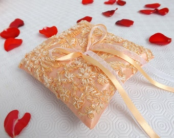 Embroidered Wedding Ring Pillow. Peach satin ring bearer decorated with peach beaded floral lace.