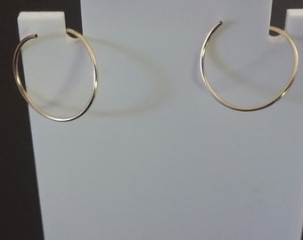 gold continuous hoop earrings