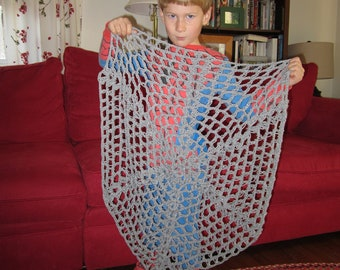 crocheted spider web for creative play