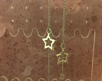 Silver colored Star Dangle Earrings