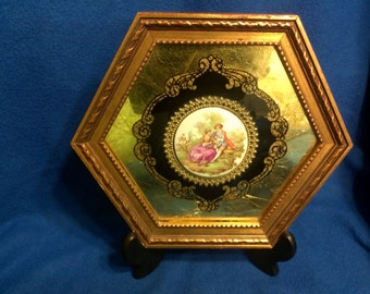A Fragonard Porcelain Wall Plaque
