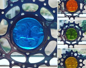 Upcycled bicycle cog glass face ornament