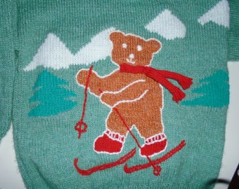 Sweater size 6, medium green, embroidered bear skier in a snowy mountain landscape.