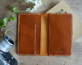 Field notes leather cover with three card pockets.