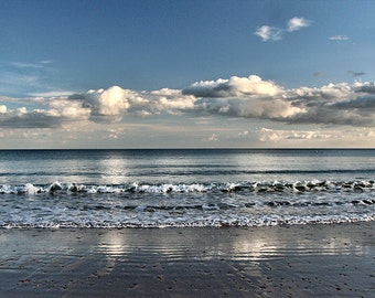 The Line. Blue sky, over the dark horizon line, clouds reflected in a wet sea sand. Square version available. Peaceful look, painting effect