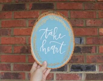 Take Heart wood slice art