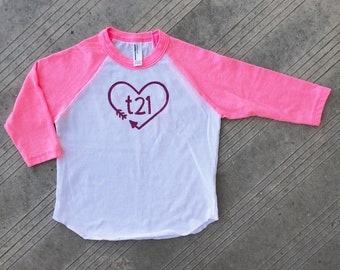 "Down Syndrome Awareness Shirts ~ Pink and White Baseball Tee with Pink ""T21"" Logo with Arrow Heart, perfect for representing T21 in pink!"