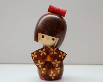 Kokeshi Doll with Red Swivel Bow Artist Signed Wooden Japanese Girl Doll