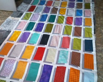 Illusion Quilt.  It is machine pieced and machine quilted.   I can make in the colors and size you would like.   Size is a generous twin.
