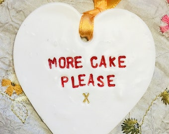 Clay 'More cake please' hanging