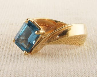 Emerald Cut London Blue Topaz in Asymmetrical 14K Yellow Gold Ring