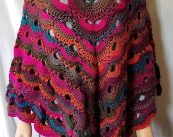 Poncho crocheted.  Very warm. Vibrant colors.   Sweater, jacket, like wearing a cozy blanket.
