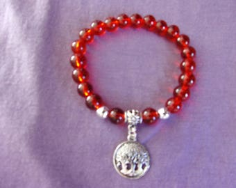 Bright red stretch bracelet with tree of life charm