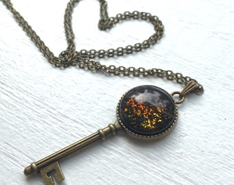 Key to my heart. Antique Brass Skeleton Key Necklace. Hand painted glass jewel. Opalescent colour changing design. Chest length necklace