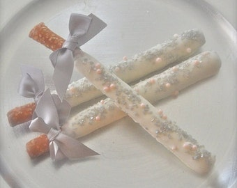 Edible Wedding Favors Silver and Pink Chocolate Dipped Pretzel Rods Frost the Cake