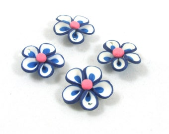 RELO SALE - Bead, polymer clay, blue and white, 18x5mm flower. Sold per pkg of 11