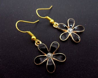 A pair of gold/black enamel flower themed dangly earrings. new.