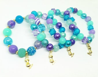 Girl's bright gold Mermaid bracelets party favors in organza bags with special birthday girl bracelet!