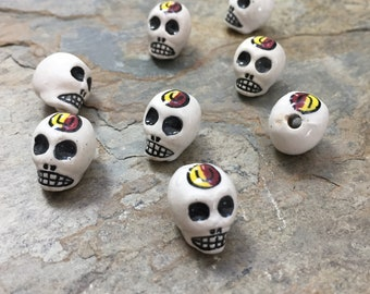 Skull Beads, White Skull Beads with Red and Yellow Design, 16 x 11mm, 8 beads per package
