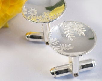 Silver Ash Leaf Cuff links: Sterling silver cuff links with an Ash leaf pattern imprinted.