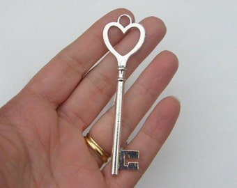 2 Key pendants antique silver tone K42