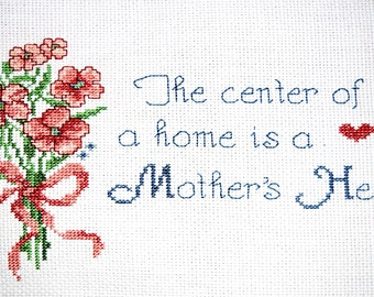 completed finished cross stitch, The center of a home is a Mother's heart