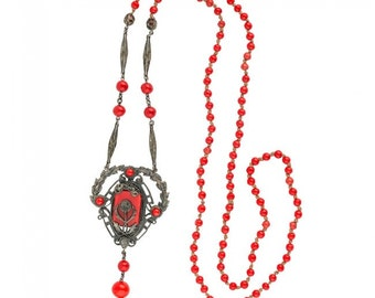 Vintage Art Deco red glass and silver metal flapper length lavaliere necklace. (nlbg2109)