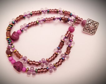 Purple skulls with purple and clear bubble glass beaded bracelet
