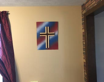 Cross on a piece of wood painted like the United States flag