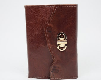 Refillable leather journal with twist latch closure