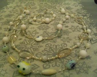 set (necklace and bracelet) stylish and original (white, translucent)