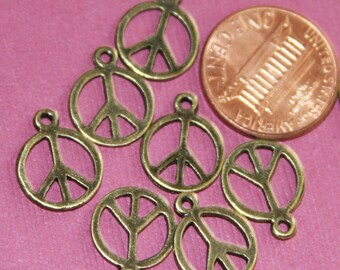 20 pcs of Antique brass peace charm 14x11mm