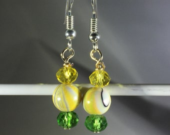 Yellow swirls with green and yellow crystals. French Hooks.