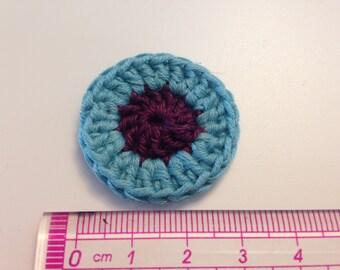 Flower rosette plum and blue green crochet