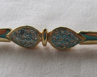 Vintage gold tone pin brooch with rhinestones