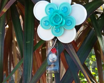 White/aqua flower badge holder
