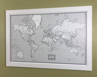 Framed Black White & Gray Push Pin World Map Shown With White Oak Frame
