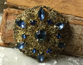 Lovely Czech Ocean Blue Rhinestone Antiqued Gold Tone Filigree Brooch Pin Unsigned 1930's 1940's Round Circular Ornate Navettes Rounds