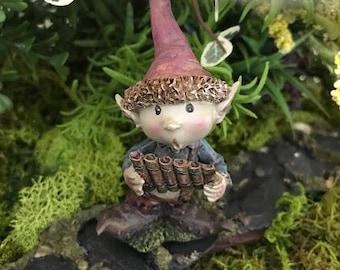 Miniature Pixie Boy Playing a Pan Flute
