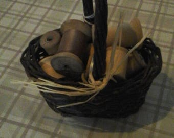 Vintage wooden spools in a basket
