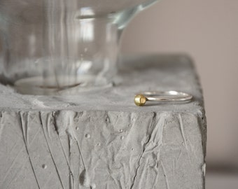 Silver ring with polished brass polygonal nugget