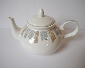 ceramic teapot with vintage lace design
