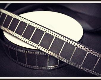 100 yard roll of black silver film ribbon